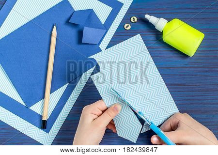 Making greeting card for Father's Day. Children's art project. DIY concept. Step-by-step photo instruction. Step 6. Child cuts out a tie