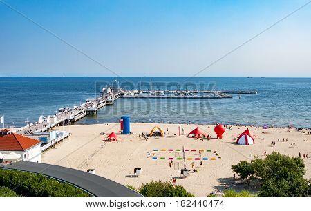 Sopot, Poland. Wooden pier (molo), beach and Baltic Sea