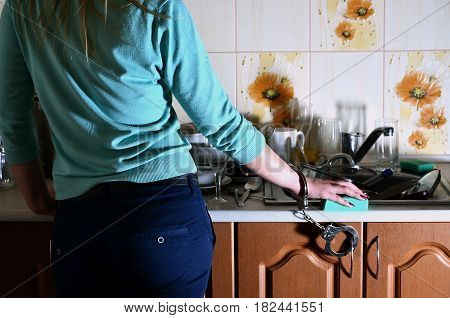 Fragment Of The Female Body, Handcuffed To The Kitchen Counter, Filled With A Lot Of Unwashed Dishes