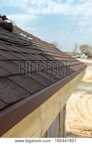 Close up of asphalt new roof shingles