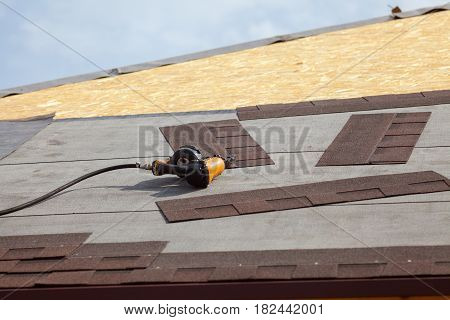 Power tools on a new roof close up