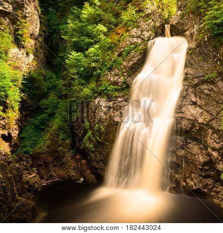 Romantic waterfalls of Foyers in Scotland at sunshine