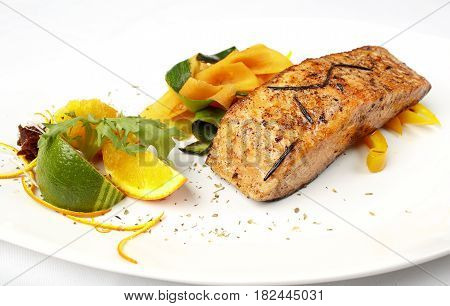 Salmon on grate with lime isolated on white background