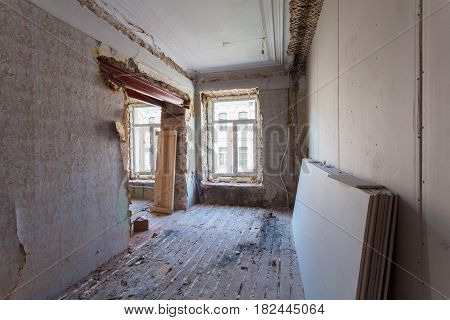 View the vintage room with fretwork on the ceiling of the apartment during under renovation remodeling and construction. ( remodeling of wall from gypsum plasterboard or drywall)