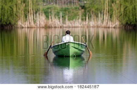 Silent couple in a rowboat. Melancholy and peaceful atmosphere