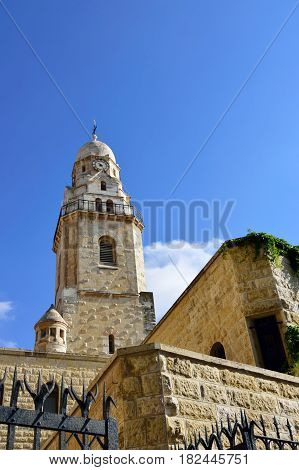 High building of Dormition Abbey in old city of Jerusalem Israel.
