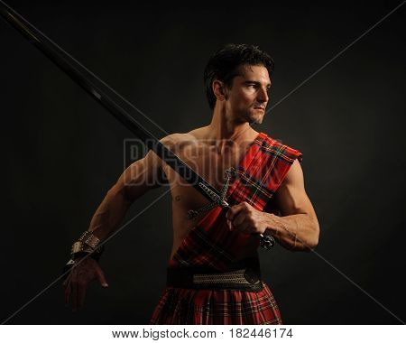 The cute warrior is holding his sword