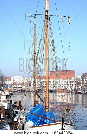 Sail boats docked in the waters of Amsterdam, Netherlands.