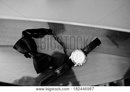 Men's Accessories For Groom At Wedding: Watches And Bow Tie.