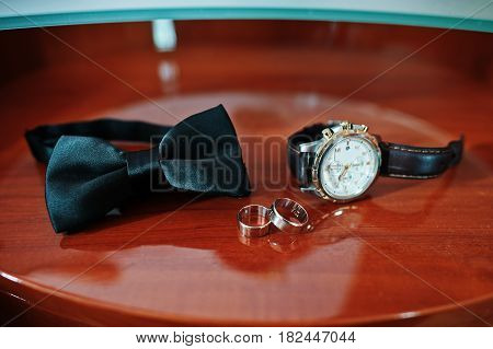 Men's Accessories For Groom At Wedding: Watches, Bow Tie And Rings.