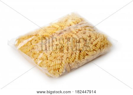 Transparent plastic bag of fusilli pasta isolated on white