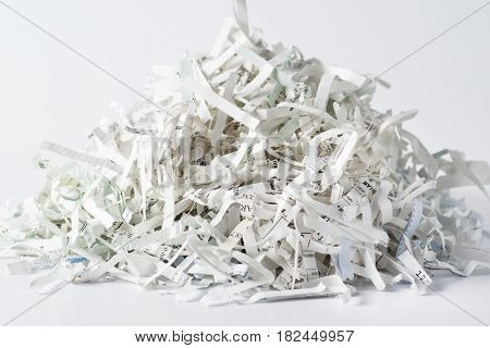 Pile of shredded paper isolated on white background