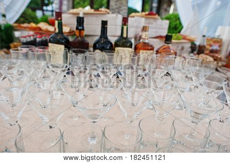 Different Alcohol Glasses At Wedding Catering Table.