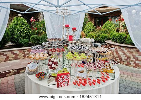 Round Wedding Catering Table With Different Sweets Outdoor.
