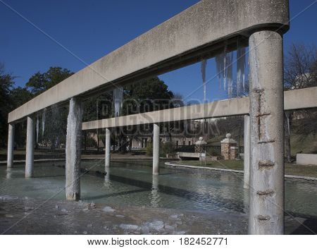 Frozen water features with icicles in San Antonio