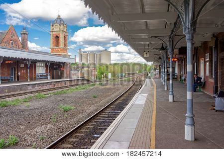 Bury St Edmunds, UK. 17th April 2017. People are on platforms at Bury St Edmunds awaiting their onward departures. The station has links to Ipswich in the East and Cambridge in the West.