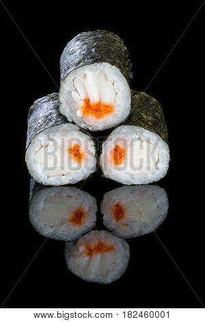 Sushi maki with squid on a black background with reflection. Asian food