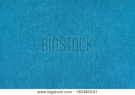 Texture of blue synthetic fabric. Background image of textile.