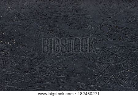 Black particleboard. Background image of chipboard. Simply texture