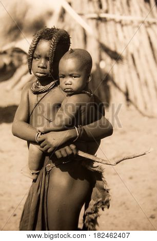 Khorixas, Namibia-April 19th 2017: picture of 2 boys of the Himba tribe.