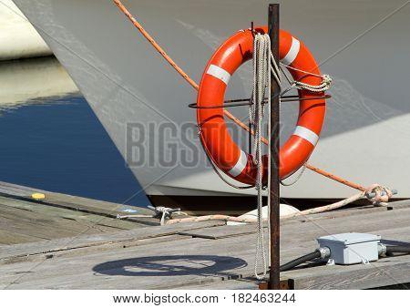 Life preserver at marina on a sunny day