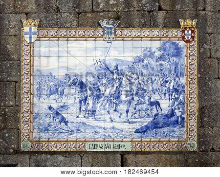 PONTE DE LIMA, PORTUGAL - OCTOBER 7, 2016: Panel of blue ceramic tiles depicting Portuguese King Afonso Henriques during a hunting scene in 1140.