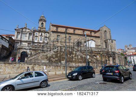 Porto, Portugal. April 17, 2014: Sao Francisco Church, right, 14th century Gothic architecture. Neoclassical architecture. Unesco World Heritage Site