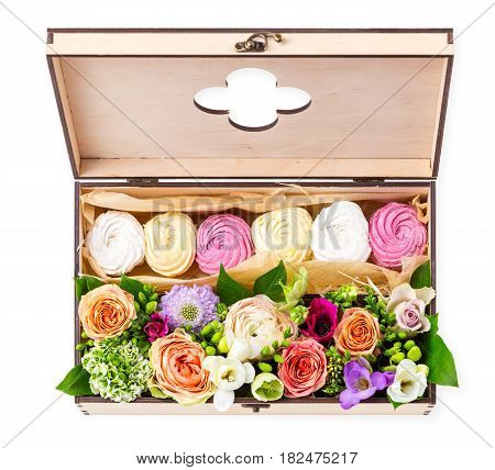 Gift box with cakes and flowers over white view from above