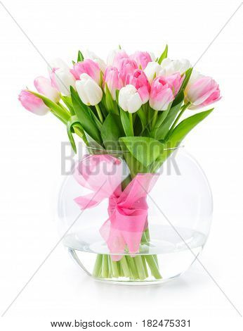 Bouquet of tulips in glass vase over white