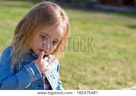 Beautiful Adorable Little Girl With Her Finger On Her Mouth