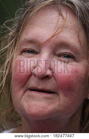 Mature female senior irish woman expressions outside.