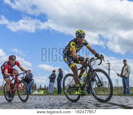 Hornaing France - April 102016: The French cyclist Yohann Gene of Direct Energie Team riding in the peloton on a paved road in Hornaing France during Paris Roubaix on 10 April 2016.