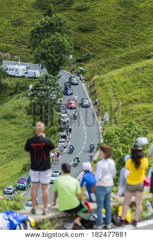 Col de PeyresourdeFrance- July 23 2014: The cyclists Vasili Kiryienka (Team Sky ) climbing as a leader the road to Col de Peyresourde in Pyrenees Mountains during the stage 17 of Le Tour de France on 23 July 2014.