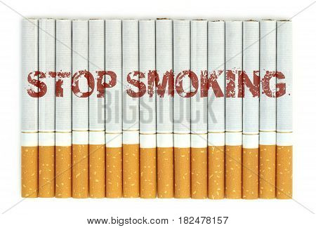 Stop smoking word on cigarettes close up image