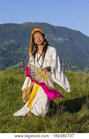 Shemale Sirena Sabiha dancing with a fan at sunrise in Pokhara Nepal. Sirena was born in the Philippines. Close up