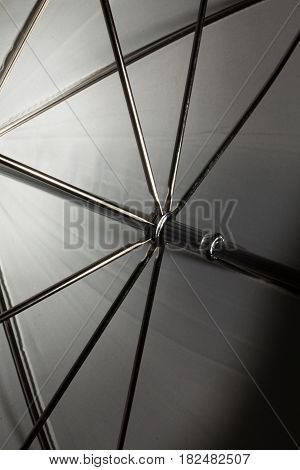Artistic concept. Abstract shot art of umbrella frame with wires light reflecting in black and white