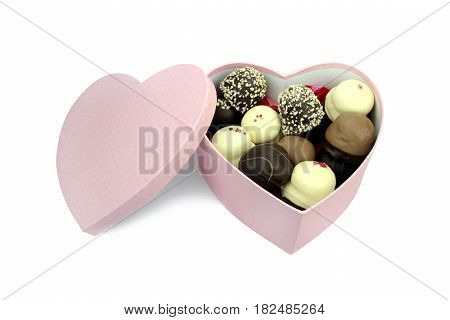 Chocolate coated cream puffs in box close up image
