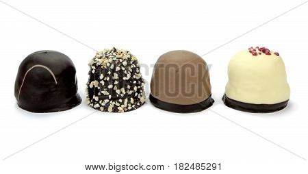 Chocolate coated cream puffs isolated on white background. Danish cuisine.