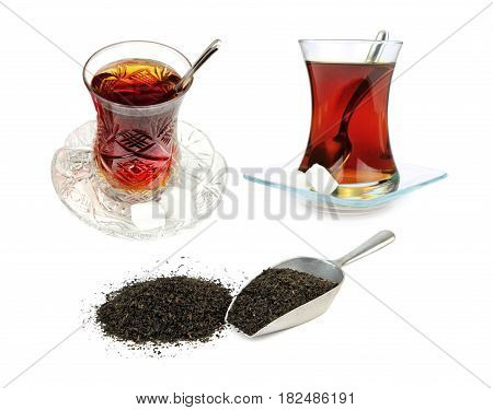 Turkish tea in traditional glasses and dry black tea leaves isolated on white background.