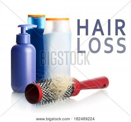 Hair loss concept. Brush and cosmetic on white background