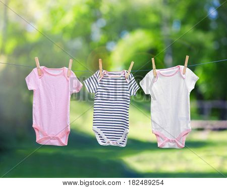 Baby laundry hanging on clothesline outdoor