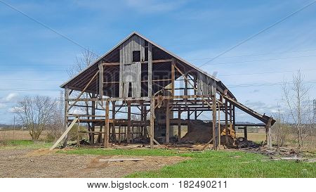 old weathered Michigan barn being dismantled on farmland