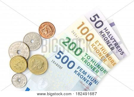 Danish kroner coins and folded banknotes ,on white background poster