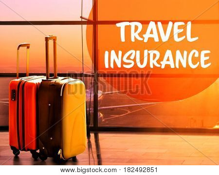 Travel insurance concept. Suitcases at airport near window