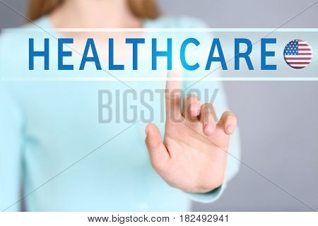 Word HEALTHCARE and woman on background