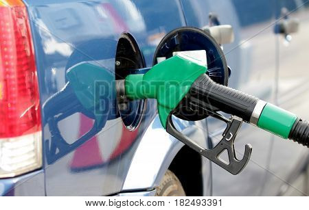 Pumping fuel in to the tank ,close up image