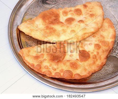Turkish cheese pie fried in oil ( Cig borek ) ( Raw pie or Tatar pie )