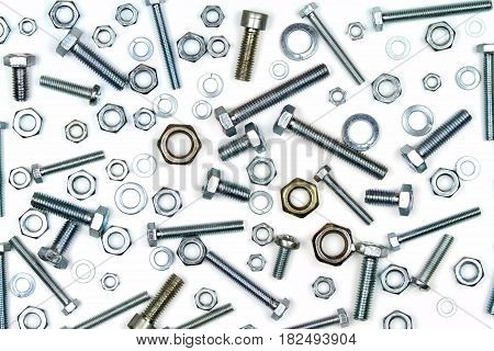 Various bolts, nuts, and washers on white background.