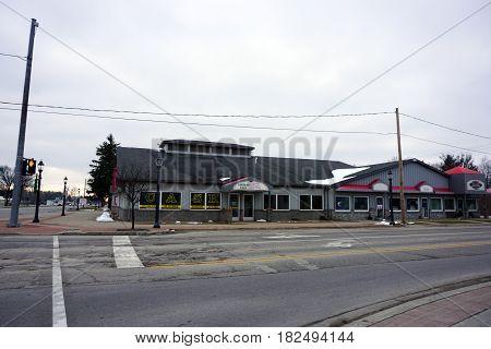 KALKASKA, MICHIGAN / UNITED STATES - NOVEMBER 27, 2016: One may obtain a loan at Quick Cash on Cedar Street in downtown Kalkaska.