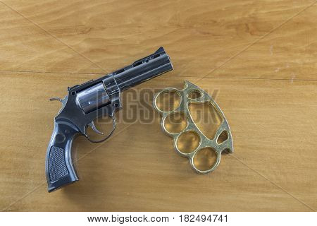 Gun brass knuckles on the wooden floor